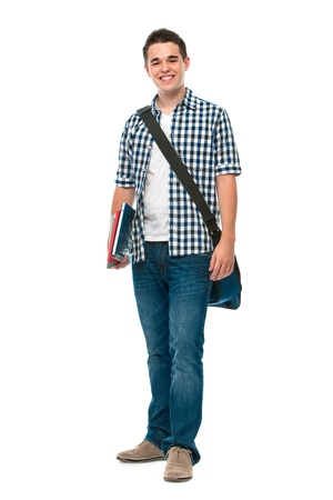 Smiling teenager with a schoolbag standing on white background photo