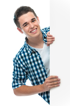 happy smiling teenager holds a blank board photo