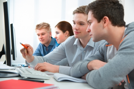 traineeship: Group of students attending training course in a computer classroom