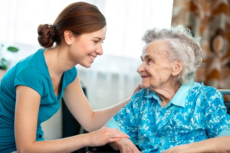 nursing service: Senior woman with her caregiver at home Stock Photo
