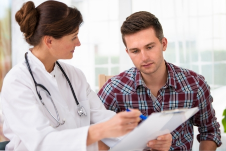 doctor talking to her male patient at office Stock Photo - 14995023