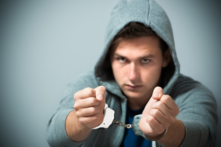 Arrested teenager with handcuffs on his hands Stock Photo - 14995025