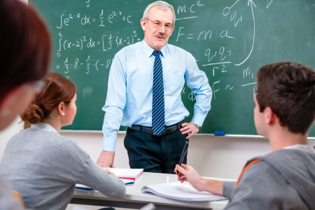 university professor: Teacher with a group of high school students in classroom Stock Photo