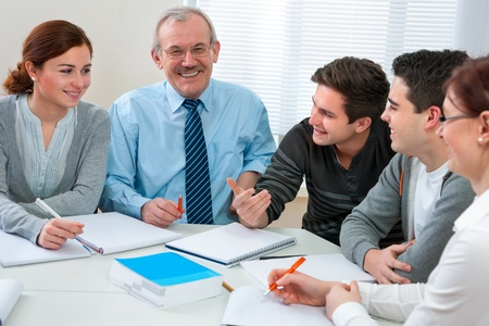 professor: Teacher with a group of high school students in classroom Stock Photo