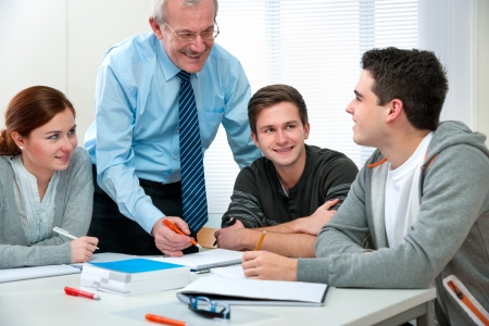 college classroom: Teacher with a group of high school students in classroom Stock Photo