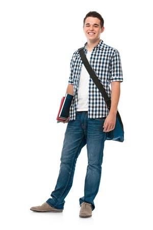 high school students: Sonrisa adolescente con un pie en el fondo blanco schoolbag