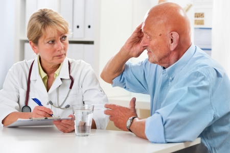 doctor examining woman: Patient tells the doctor about his health complaints
