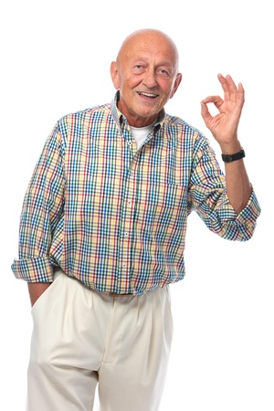 senior man: Portrait of a happy senior man smiling isolated on white Stock Photo