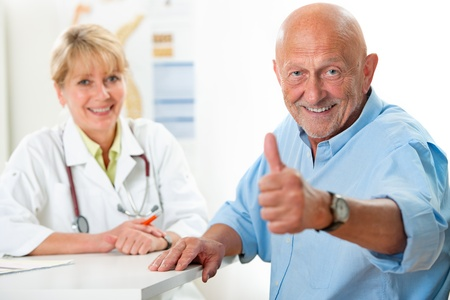 doctor examining woman: Happy senior patient and doctor at the doctor