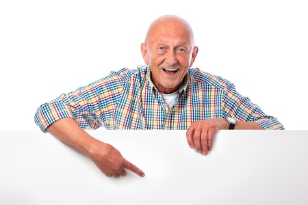 a placard: happy smiling senior man holds a blank board isolated on white Stock Photo