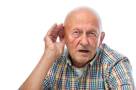 listening to people: Senior man cupping his ear having difficulty hearing