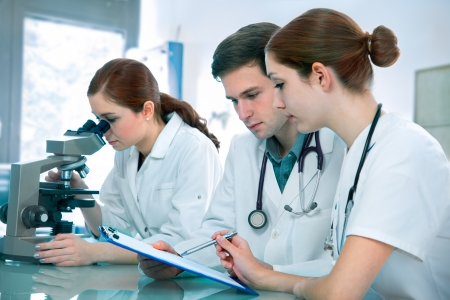 experimentation: Group of young clinicians experimentation in research laboratory Stock Photo