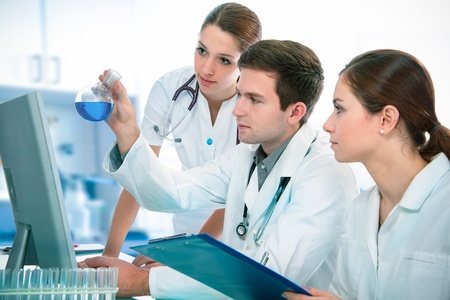 clinical: Group of young clinicians experimentation in research laboratory Stock Photo