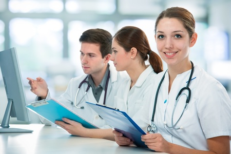 faculty: group of medical students studying in classroom Stock Photo