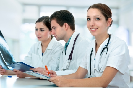 medical physician: Group of medical students studying in classroom Stock Photo