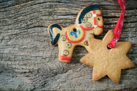 Christmas gingerbread cookies over wooden background photo