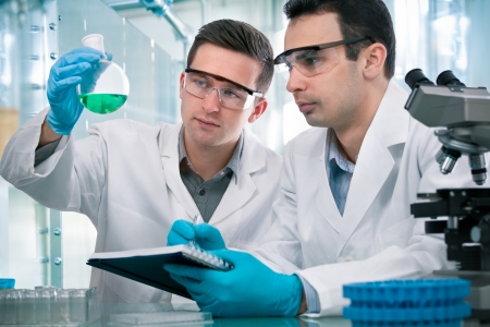 Two scientists  working in a research laboratory Stock Photo - 17081835