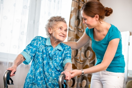 Senior woman with her caregiver at home Stock Photo - 17109725