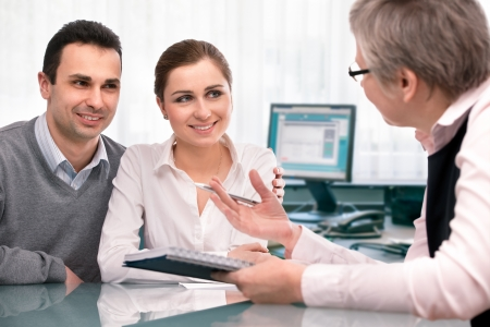 financial planning: Cheerful young couple at financial planning consultation