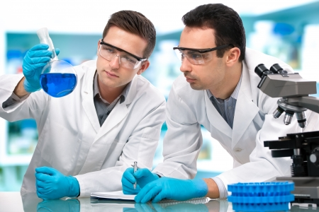 Two scientists  working in a research laboratory photo