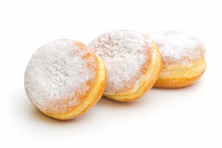 sugary: three sugary donuts on a white background Stock Photo