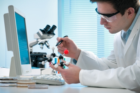 molecular structure: scientist with a molecular structure at the laboratory