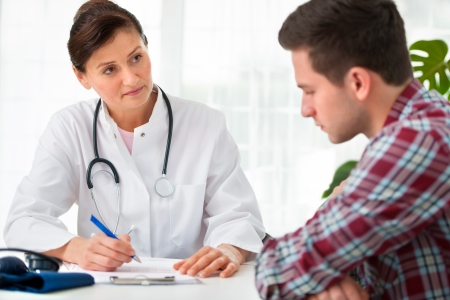 doctor talking to her male patient at office Stock Photo - 17801412