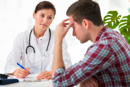 psychiatrist: doctor talking to her male patient at office