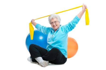 physical exercise: senior woman doing exercises with a resistance band Stock Photo