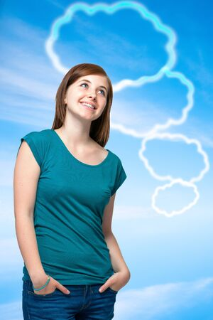 Teenager girl with blank thought bubbles on blue sky background photo
