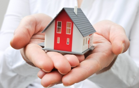 Hands presenting a small model of a house Stock Photo - 18030871