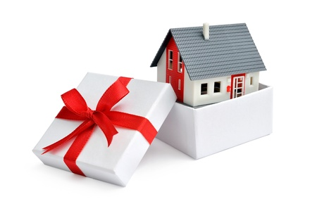 Model of a house in gift box with red ribbon Stock Photo - 18148500