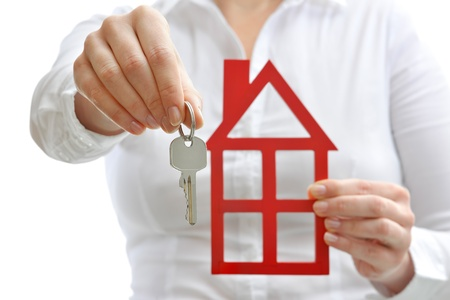 renter: Real estate agent with house model and keys Stock Photo