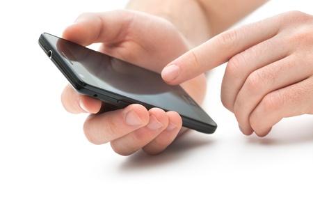 trabajo social: Mano que toca la pantalla en moderno tel�fono m�vil inteligente