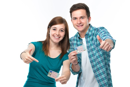 apprentice: Happy teens showing their driving license