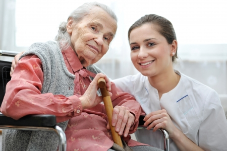 healthcare workers: Senior woman with her caregiver at home Stock Photo