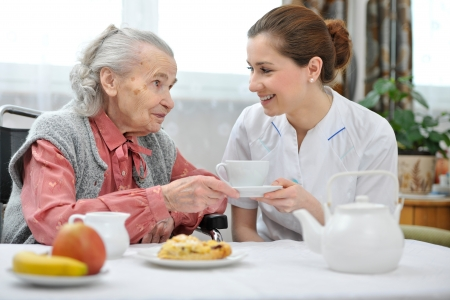 healthcare workers: Senior woman eats lunch at retirement home