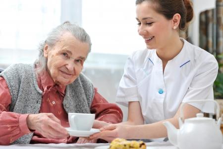 impairment: Senior woman eats lunch at retirement home