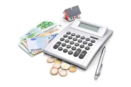 House, calculator and money isolated on white background Stock Photo - 20921508