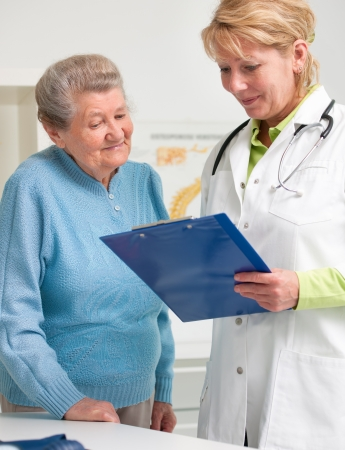 doctor visit: doctor explaining diagnosis to her female patient Stock Photo