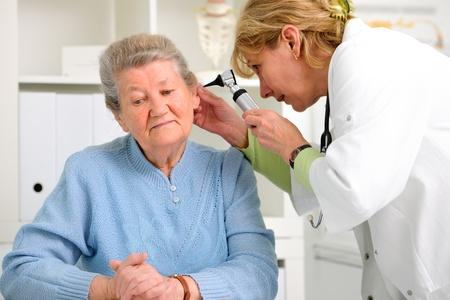 exam room: doctor examining senior patient Stock Photo