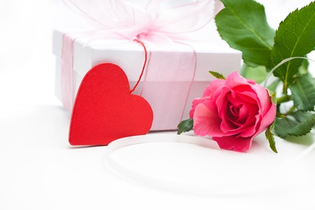 Rose and gift box over white background photo