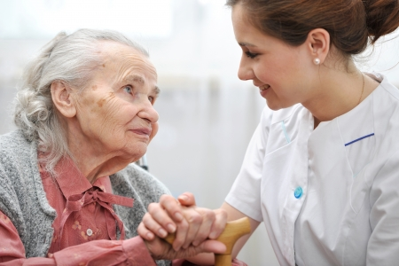 healthcare: Senior woman with her caregiver at home Stock Photo