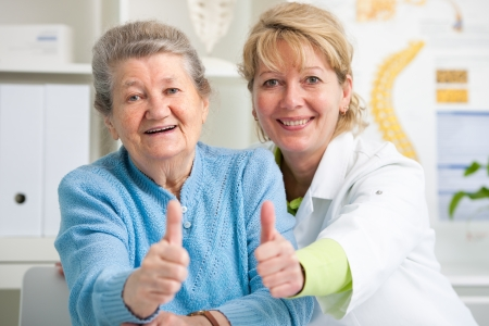 Happy senior patient and doctor at the doctor Stock Photo - 20947480