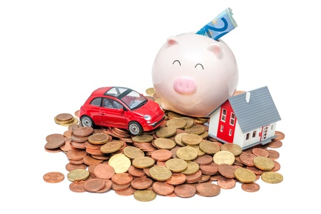 Piggy bank and house on the white background photo
