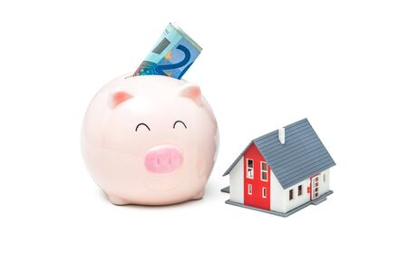 Piggy bank and house on the white background Stock Photo - 21160103