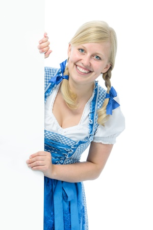 beerfest: young woman in dirndl holds ad space and smile Stock Photo