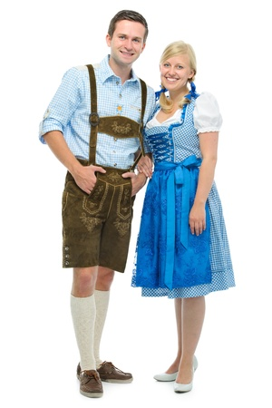 beautiful couple in traditional bavarian tracht isolated on white photo