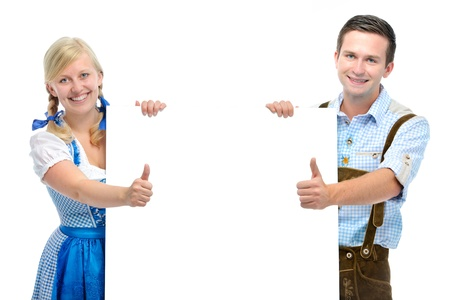 happy couple stand behind billboard and show thumbs photo