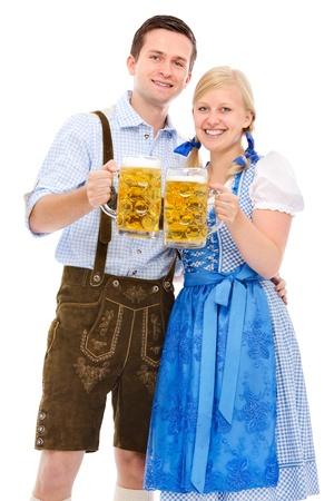 wiesn: happy bavarian couple in dirndl with oktoberfest beer